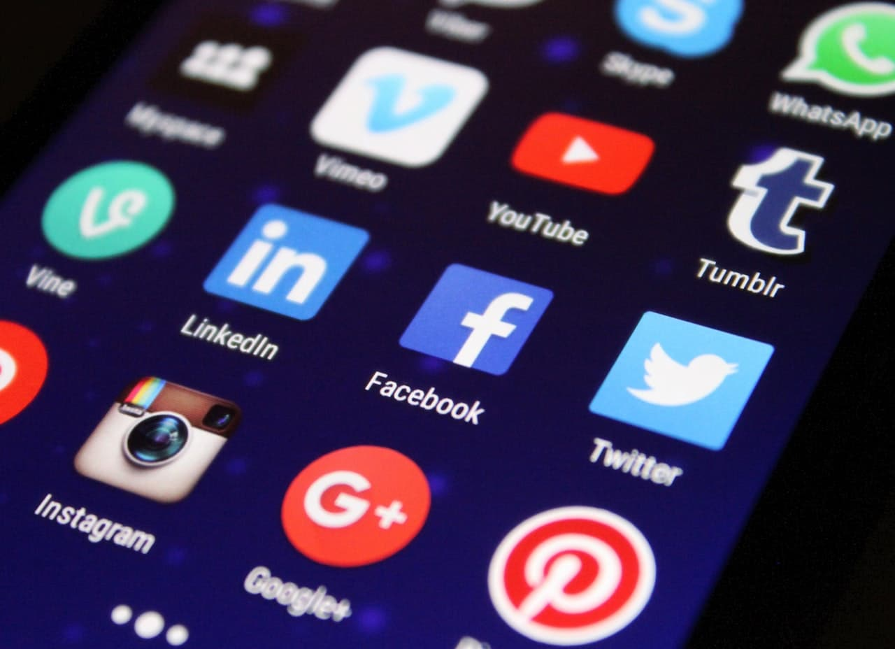 Photo of a smartphone with social media app icons.