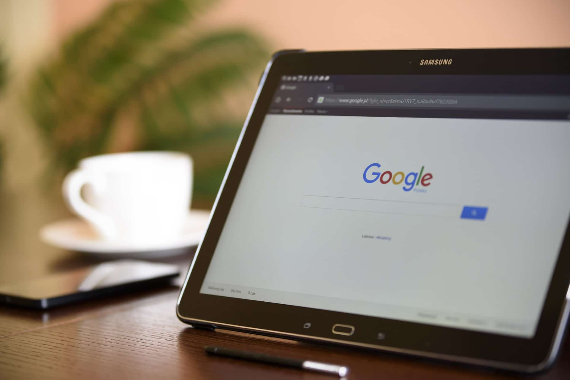 Photo of a tablet showing the Google home page.